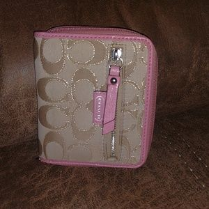 Pink and tan Coach wallet